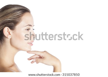 Profile of a beauty woman face skin and hand manicure isolated on a white background - stock photo