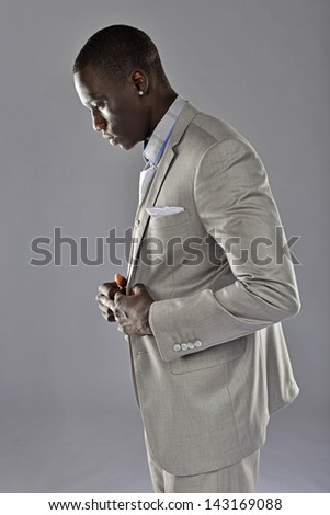 Profile of a black man in a business suit. - stock photo