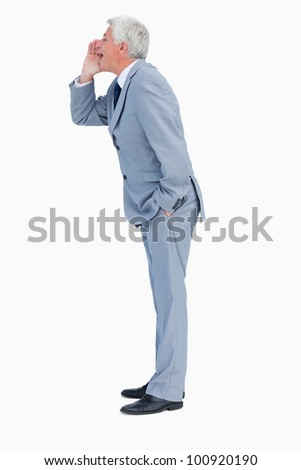 Profile of a businessman shouting against white background