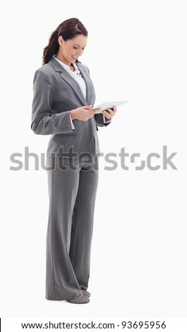Profile of a businesswoman smiling while watching a touch pad against white bacground - stock photo