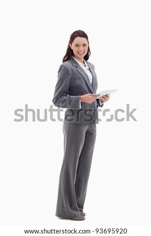 Profile of a businesswoman with a touch pad against white background - stock photo
