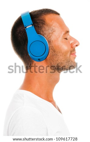 Profile of a man with ear-phones isolated on white