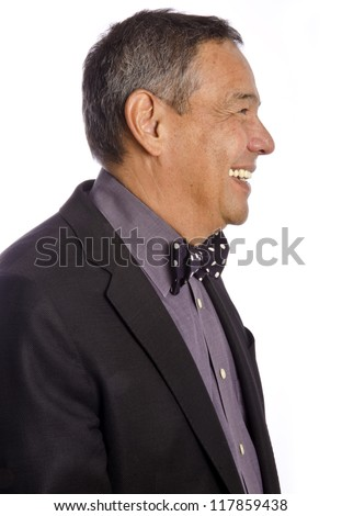 Profile of a Mature Hispanic Man in a Suit and Polka Dot Bow Tie - stock photo