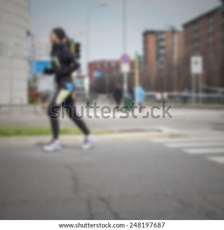Profile of a runner, background. Intentionally blurred post production.
