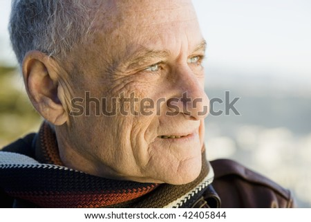 Profile Of A Senior Man Looking Out to Sea - stock photo