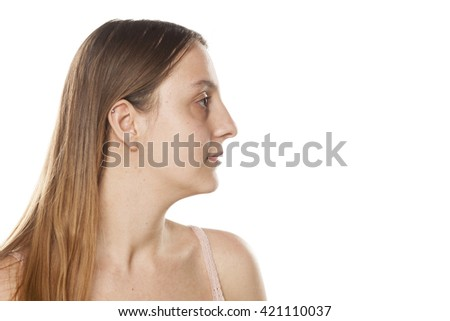 profile of a serious young woman without makeup on a white background