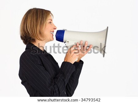 Profile of a smiling businesswoman shouting through a megaphone
