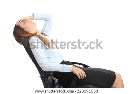 Profile of a tired businesswoman sitting on a chair isolated on a white background - stock photo