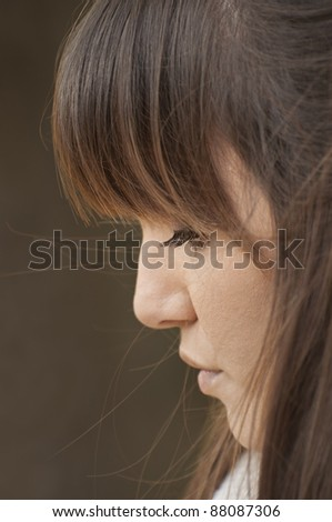 Profile of a woman close up - stock photo