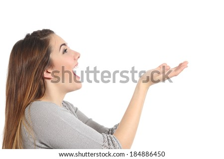 Profile of a woman holding something blank surprised isolated on a white background        - stock photo