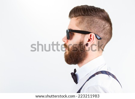 profile  of a young fashionable hipster man wearing elegant clothes isolated on white