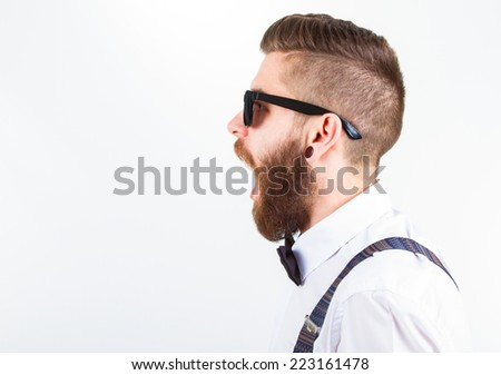 profile  of a young hipster man wearing elegant clothes and eyeglasses with open mouth - stock photo