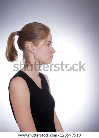 Profile of a young woman - stock photo