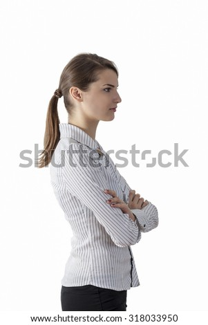 Profile of a young woman with ponytail against a white background. - stock photo