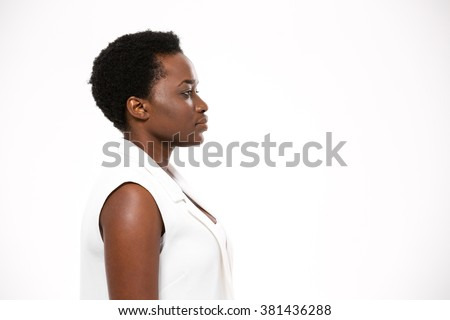 Profile of beautiful serious african american young woman with short haircut over white background - stock photo