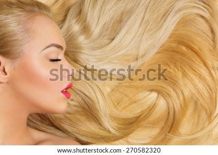 Profile of beautiful woman with long silky blond hair - stock photo