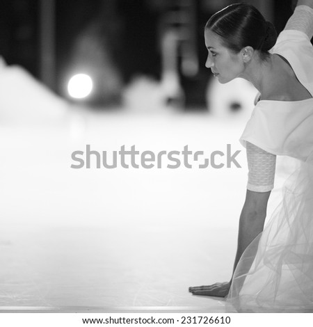 Profile of beautiful young woman on the stage - stock photo