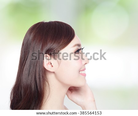 profile of beauty woman with health skin, teeth and hair isolated on green background, asian beauty