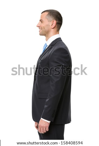 Profile of business man wearing black suit and blue tie, isolated on white - stock photo