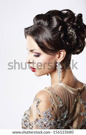 Profile of Classy Brown Hair Lady with Jewelry and Festive Hairstyle - stock photo