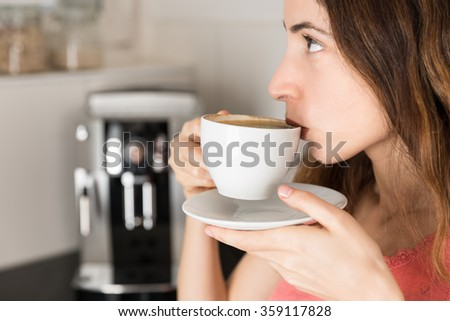 Profile of coffee drinking woman