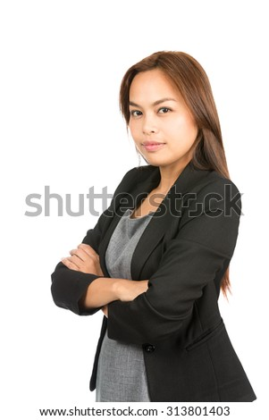 Profile of confident, no-nonsense Asian career professional in black business jacket, dress looking at camera showing strong, leadership, competent attitude. Thai national of Chinese origin.