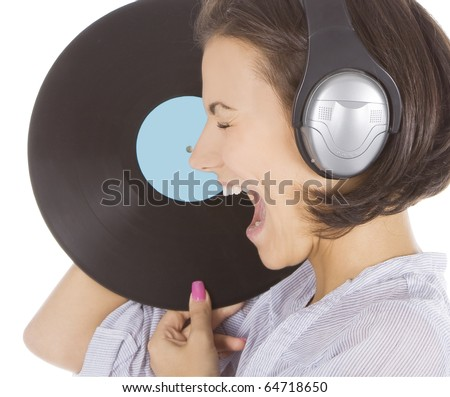 Profile of emotional brunette in headphones with vinyl record over white - stock photo