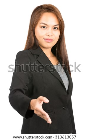 Profile of friendly, warm Asian businesswoman in black business suit grinning, extending hand offering handshake making agreement looking at camera. Thai national of Chinese origin. Vertical half