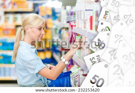 Profile of girl at the shop choosing cosmetics among the great variety of products on clearance sale. Concept of consumerism, retail and purchase - stock photo