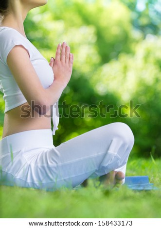 Profile of girl who sits in asana position prayer gesturing. Concept of healthy lifestyle and gratitude