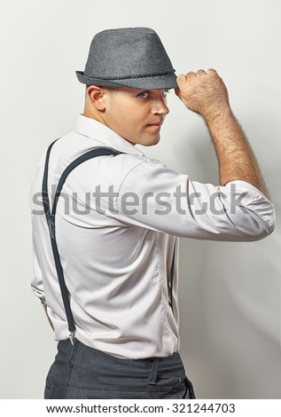 Profile of handsome gentleman in hat on white