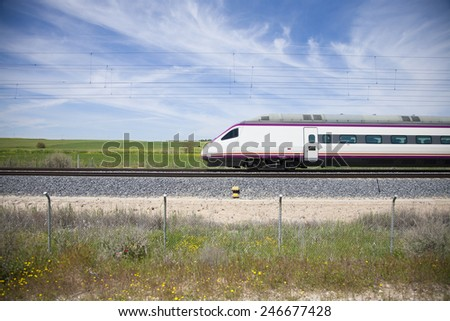 profile of locomotive train in a landscape from Spain - stock photo