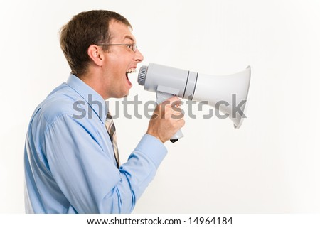 Profile of man shouting through megaphone isolated over white background