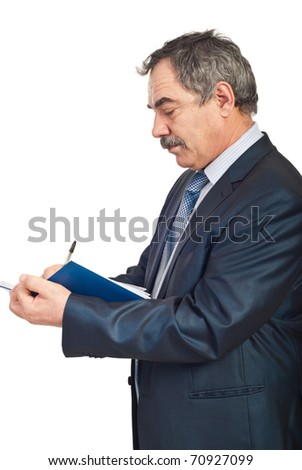 Profile of mature business man writing in personal agenda isolated on white background