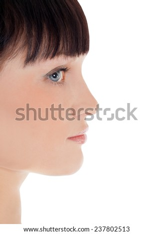 Profile of pretty woman face over white