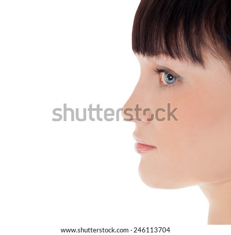 Profile of pretty woman face over white - stock photo