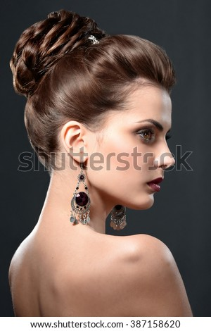 Profile of sexy brunette woman with evening make-up and hairstyle. Beauty face and perfect skin. - stock photo