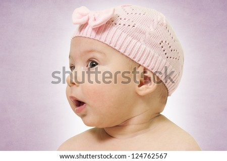 Profile of the baby girl on purple background