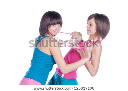 Profile of two women in struggle on white - stock photo
