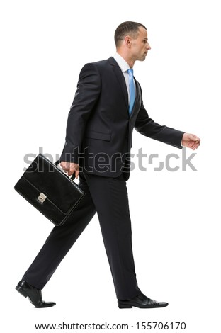 Profile of walking with case businessman, isolated on white. Concept of leadership and success