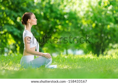 Profile of woman who sits in asana position. Concept of healthy lifestyle and relaxation