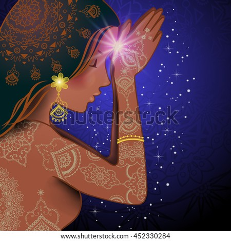 Profile of woman with hands in Namaste gesture, with decorative background - stock photo