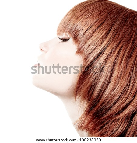 profile of young beautiful redheaded teen girl. isolated on white background. - stock photo