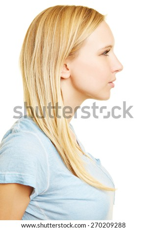 Profile of young blonde woman in side view - stock photo