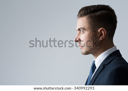 Profile of young businessperson on gray background