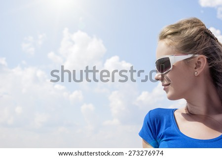 Profile of Young Smiling Caucasian Blond Female Wearing Sunglasses. Horizontal Image Orientation - stock photo