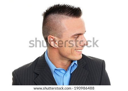 Profile of young smiling man in suit