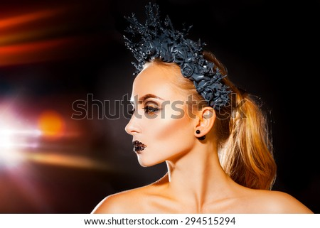 profile photo of sexy woman with wreath on head and cute makeup in studio