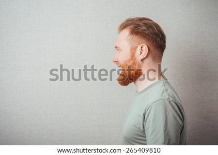 Profile portrait of a bearded man - stock photo