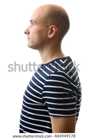 profile portrait of a handsome young man in striped t-shirt. Isolated on a white background